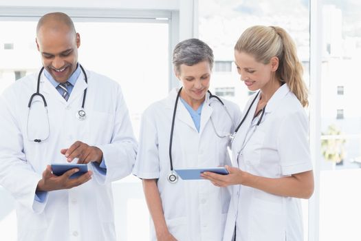Team of smiling doctors working on their files