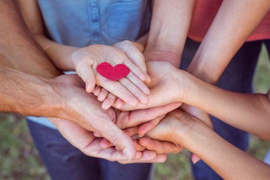 Friends holding a heart