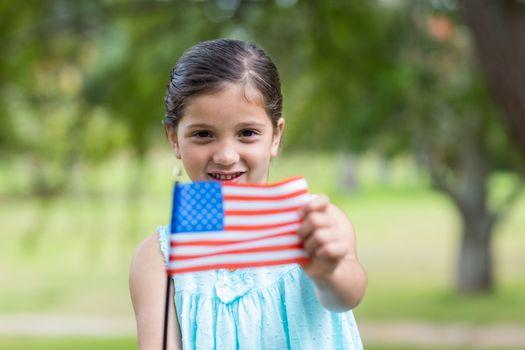 Little girl waving american flag