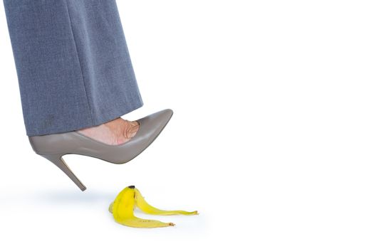 Woman with heel shoes walking on banana