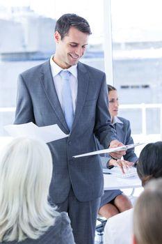 Businessman give a paper