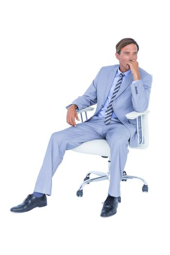 Handsome businessman sitting on a swivel chair