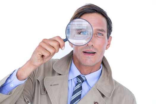 Spy looking through magnifier