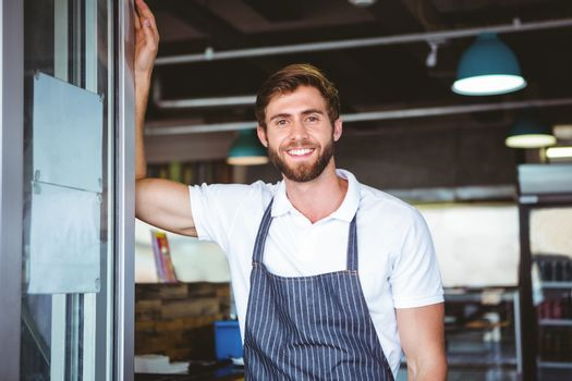 Smiling server in apron