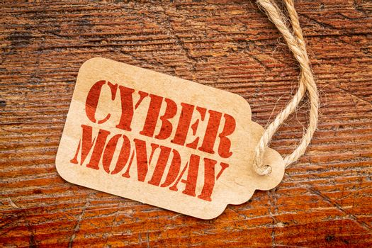 Cyber Monday sign - a paper price tag against rustic red painted barn wood