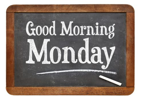 Good Morning Monday sign on a vintage slate blackboard with white chalk