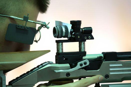 young man aiming a pneumatic air rifle