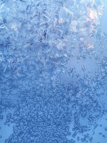 Texture of beautiful ice pattern on winter glass