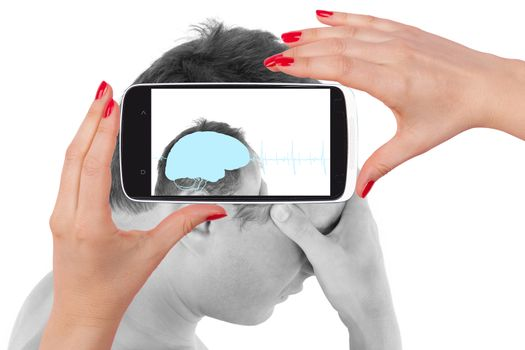 Headache. Young man touching his head and seeing the diagnosis on a smartphone screen. The future of medicine.