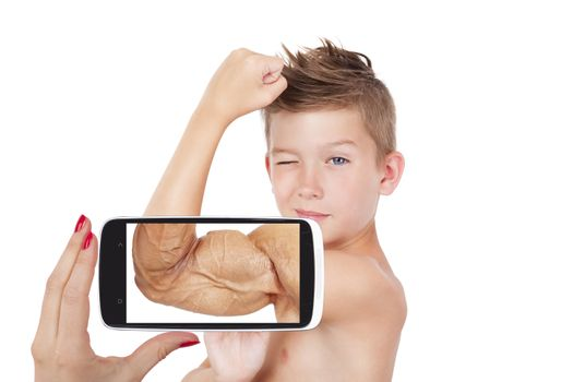 Vision of success. Charming boy showing muscle with future vision on smartphone screen. Seeing the future, self confidence and self perception.