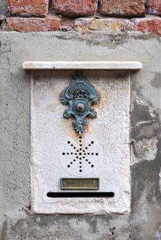 Traditional decorative doorbell in Venice, Italy