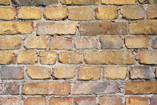 Patterned brick wall with imperfect grout.