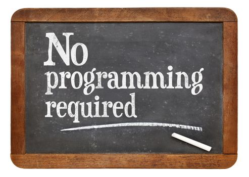 No programming required sign - white chalk text  on a vintage slate blackboard