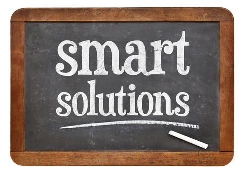 Smart solutions sign - white chalk text on a vintage slate blackboard