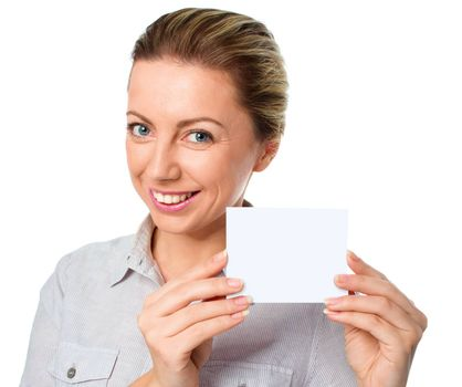 Attractive young woman showing empty blank paper card sign with copy space for text, isolated over white