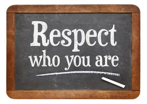 Respect who you are - motivational advice  on a vintage slate blackboard
