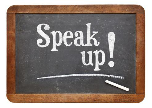 Speak up encouragement - motivational text  on a vintage slate blackboard