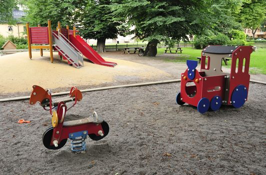 A colorful playground in a park.