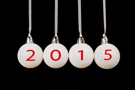 Four white christmas balls with year 2015