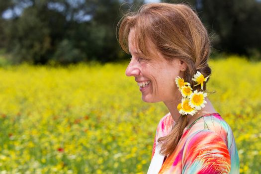 european woman wearing braid with yellow flowers near coleseed f