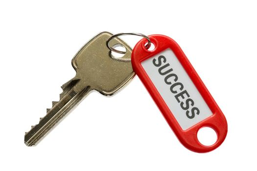 Modern key with red label with text success against a white background