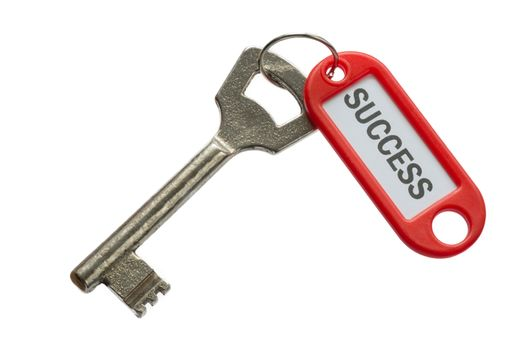 Old key with red label with text success against a white background