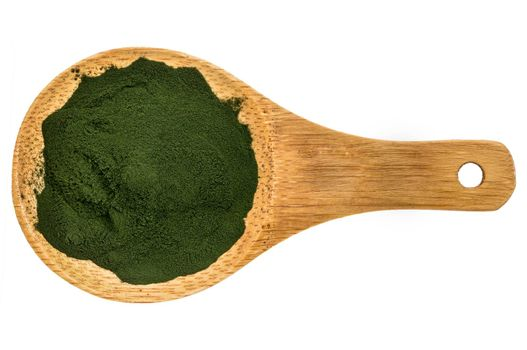 Nutrient-rich organic spirulina powder on a wooden spoon, isolated on white, top view