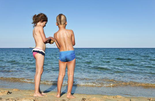 kids sharing childhood remote beach