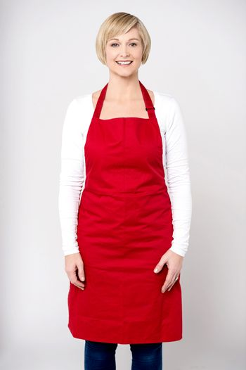 Casual pose of happy female chef
