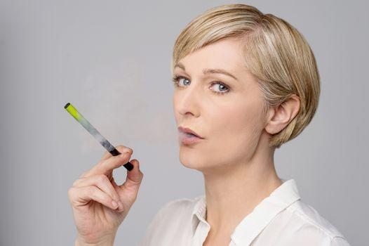 Woman with e-cigarette.