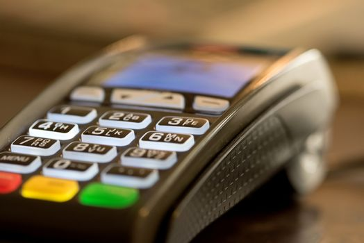 Close up image of credit card swipe machine