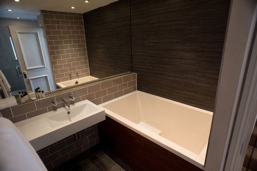Modern bathroom with glass screened shower