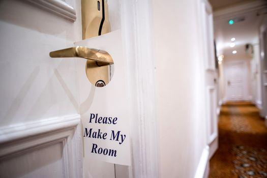 Demand sign label on door knob in hotel