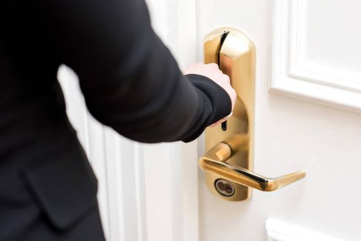 Woman hand inserting key card in electronic lock