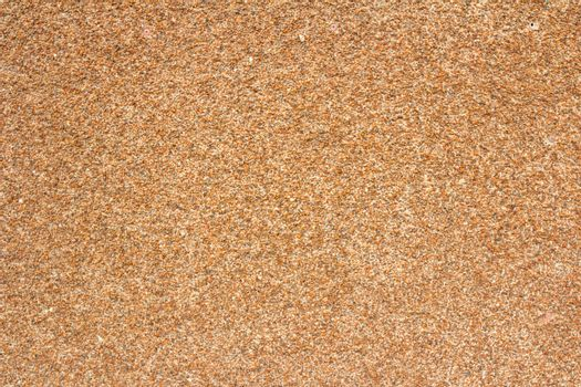 Background in the form of crushed stone brown wall