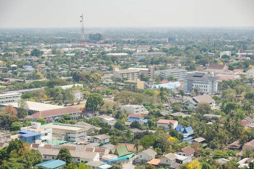 Buildings and towers in Phetchaburi taken from a high angle panoramic view of the city.