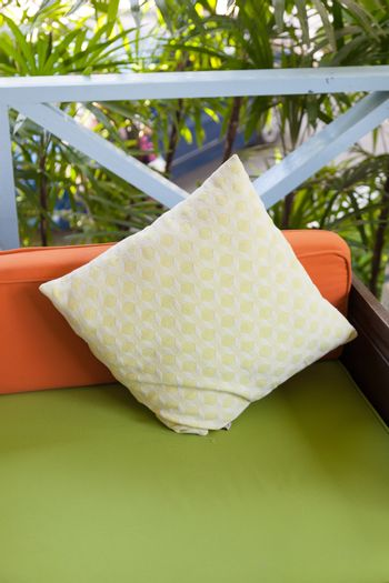 Pillows on sofa. Pillow Place squares on a couch on the porch.