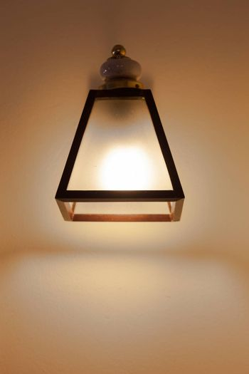 Rectangular lantern mounted on the Wall in the bedroom.