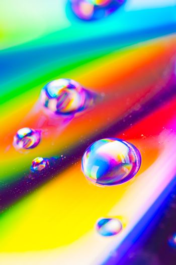 Colorful water drops macro water drops with a colorful background.