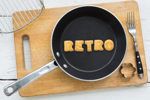 Letter biscuits word RETRO and cooking equipments.