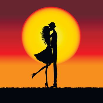 Natural sunset landscape with lovers silhouette.