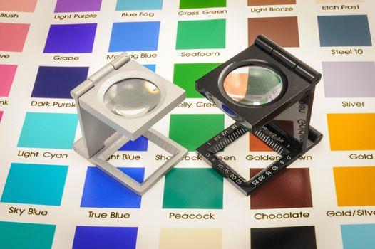 Twin magnifier loupes color management on color chart.