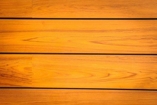 Modern brown pattern of teak wood  in background.