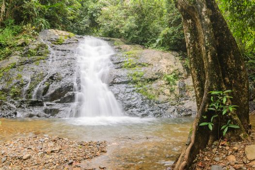 Beautiful little waterfall in rain forest, Thailand.