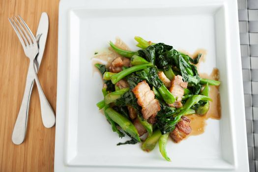 Thai style crispy pork dish with Chinese broccoli.