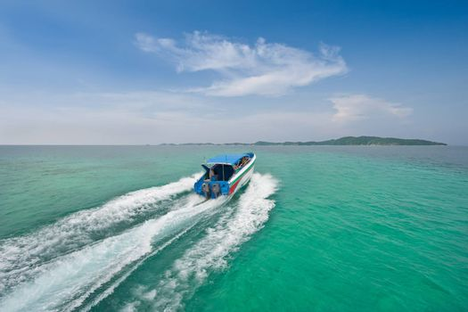 Speed boat to island in the sea two colors
