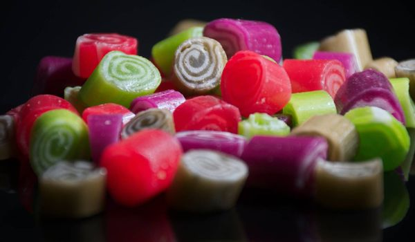 Colorful candies on black background