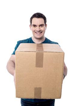 Happy casual man giving a big cardboard box