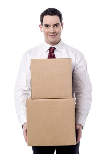 Corporate man carrying a cardboard boxes in hand