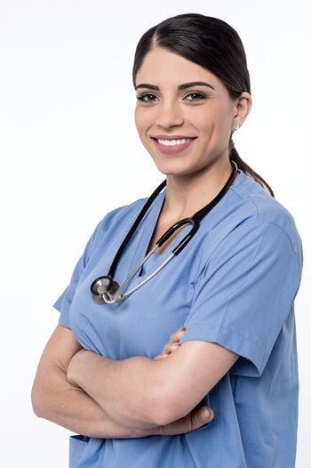 Confident female doctor with her arms folded